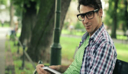Sstock-footage-young-happy-man-reading-book-in-the-park