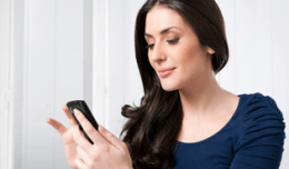 Wwoman-organizing-contacts-on-smartphone