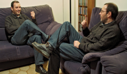Two-men-talking-at-home-1