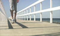 Sstock-footage-a-man-walking-on-a-jetty
